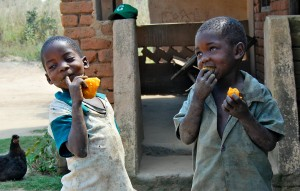 Children enjoying orange sweet potato. Credit, HarvestPlus.