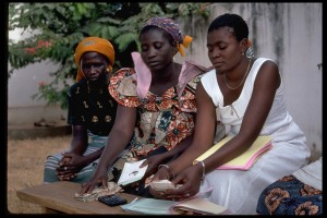 Women count money at a local micro credit lending station in Togo. Credit, A. Rogers, UNCDF.