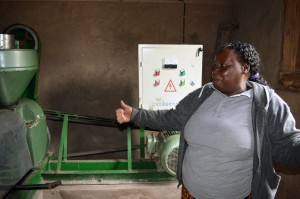 Emilia with her sunflower oil machine. Credit, Agriculture for Imapct.